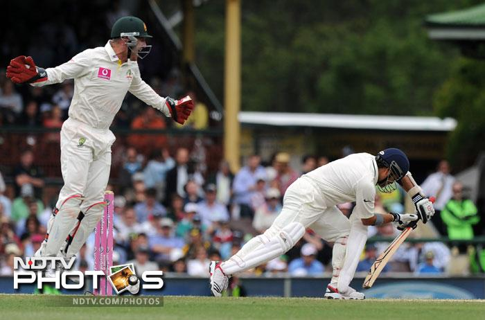 Brad Haddin rejoices as Sachin Tendulkar is caught at first slip by Mike Hussey off Michael Clarke for 80 during the second Test against Australia and the 100th Test at the Sydney Ground. (AFP Photo)