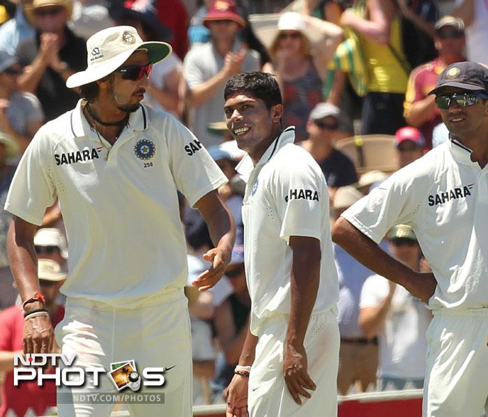 Umesh Yadav celebrates with his teammates after bowling out Michael Clarke for 210 runs on Day 2 of the fourth Test between India and Australia in the Border-Gavaskar Trophy Series at the Adelaide Oval. (AFP Photo)