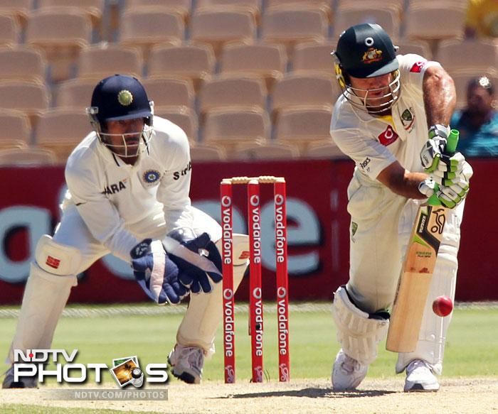 Ricky Ponting drives the ball on Day 4 of the fourth Test match against India in the Border-Gavaskar Trophy Series at the Adelaide Oval. (AFP Photo)