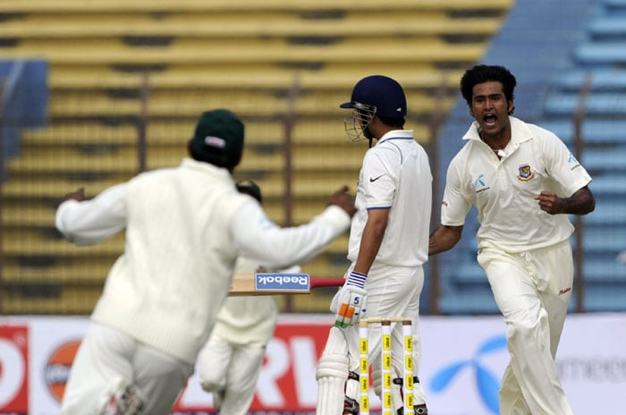 Shahadat Hossain celebrates as his teammate Imrul Kayes runs in joy after the dismissal of Gautam Gambhir during the first day of the first Test match between Bangladesh and India at Zohur Ahmed Chowdhury Stadium in Chittagong. (AFP Photo)
