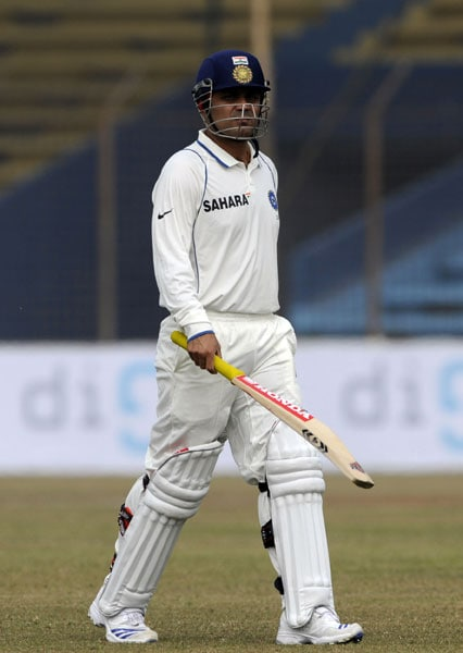 Virender Sehwag leaves the field after loosing his wicket during the first day of the first Test match between Bangladesh and India at Zohur Ahmed Chowdhury Stadium in Chittagong. (AFP Photo)
