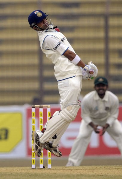 Gautam Gambhir jumps to avoid a bouncer during the first day of the first Test match between Bangladesh and India at Zohur Ahmed Chowdhury Stadium in Chittagong. (AFP Photo)