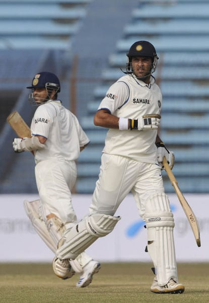 Sachin Tendulkar and Yuvraj Singh run between the wickets during the first day of the first Test match between Bangladesh and India at Zohur Ahmed Chowdhury Stadium in Chittagong. (AFP Photo)