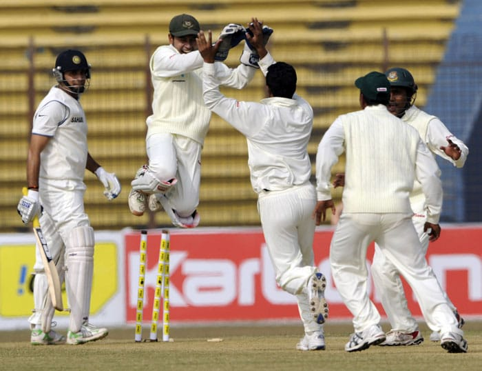 Mushfiqur Rahim celebrates with teammates after the dismissal of VVS Laxman during the first day of the first Test match between Bangladesh and India at Zohur Ahmed Chowdhury Stadium in Chittagong. (AFP Photo)