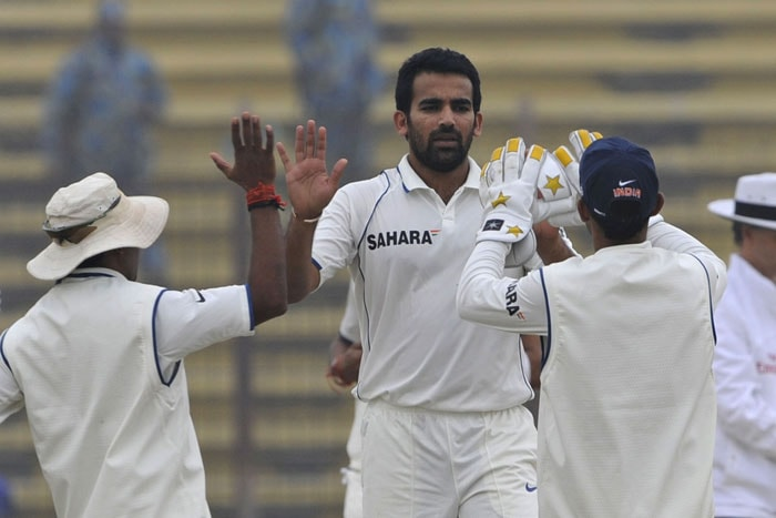 Zaheer Khan celebrates with his teammates after the dismissal of the Imrul Kayes during the second day of the first Test match between Bangladesh and India in Chittagong. (AFP Photo)