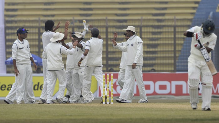 Indian cricketers celebrate the dismissal of Shahriar Nafees (R) during the second day of the first Test match between Bangladesh and India in Chittagong. (AFP Photo)