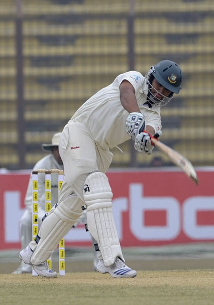 Tamim Iqbal plays a shot during the second day of the first Test match between Bangladesh and India in Chittagong. (AFP Photo)