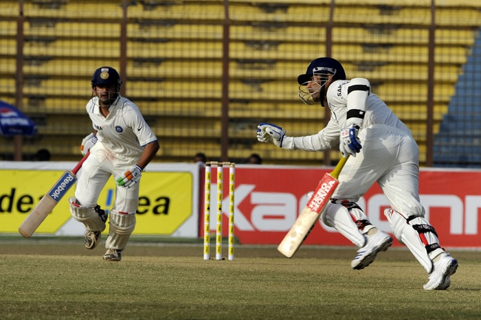 Virender Sehwag and teammate Gautam Gambhir run between the wickets during the third day of the first Test match between Bangladesh and India at Zohur Ahmed Chowdhury Stadium in Chittagong. (AFP Photo)