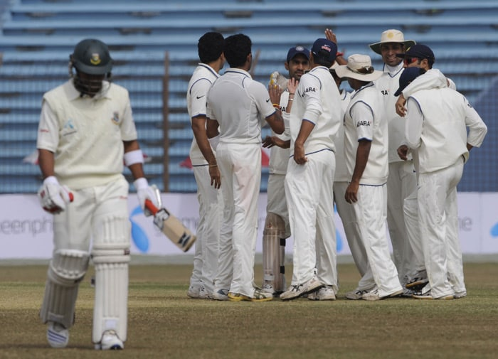 Indian cricketers celebrate the dismissal of Raqibul Hasan during the third day of the first Test match between Bangladesh and India at Zohur Ahmed Chowdhury Stadium in Chittagong. (AFP Photo)