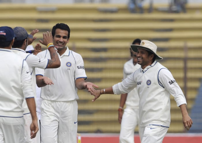 Zaheer Khan celebrates with his teammate Sachin Tendulkar after the dismissal of unseen Bangladeshi cricket team captain Shakib Al Hasan during the third day of the first Test match between Bangladesh and India at Zohur Ahmed Chowdhury Stadium in Chittagong. (AFP Photo)