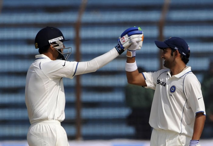 Rahul Dravid congratulates his teammate Gautam Gambhir for scoring a century (100 runs) during the fourth day of the first Test match between Bangladesh and India at Zohur Ahmed Chowdhury Stadium in Chittagong. Indian Gautam Gambhir became the fourth batsman to hammer a century in five successive matches as India consolidated their position in the first Test against Bangladesh. The left-handed opener cracked a solid 116 to help India reach 259-4 in their second innings at lunch on the penultimate day. (AFP Photo)