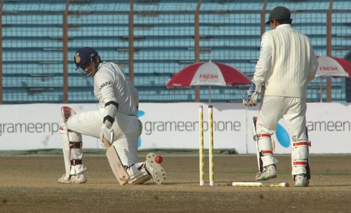 Zaheer Khan is bowled by unseen Bangladeshi team captain Shakib Al Hasan as teammate Mushfiqur Rahim looks on during the fourth day of the first Test match between Bangladesh and India at Zohur Ahmed Chowdhury Stadium in Chittagong. (AFP Photo)