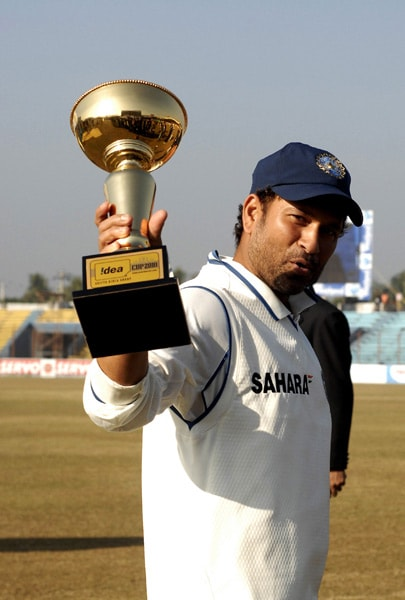 Sachin Tendulkar displays his Man of the Match trophy at the conclusion of the fifth day of the first Test match between Bangladesh and India at Zohur Ahmed Chowdhury Stadium in Chittagong. India won the match by 113 runs. (AFP Photo)
