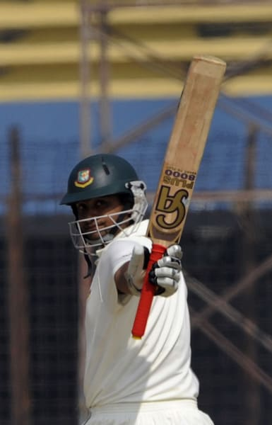 Tamim Iqbal raise his bat after scoring a half-century (50 runs) during the fifth day of the first Test match between Bangladesh and India in Chittagong. (AFP Photo)