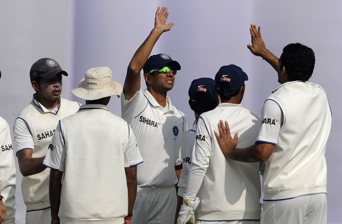 Indian cricketers celebrate the dismissal of Mohammad Ashraful during the fifth day of the first Test match between Bangladesh and India in Chittagong. (AFP Photo)