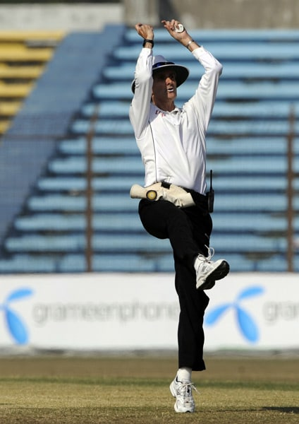 Cricket umpire Billy Bowden shows a six boundary signal during the fifth day of the first Test match between Bangladesh and India in Chittagong. (AFP Photo)