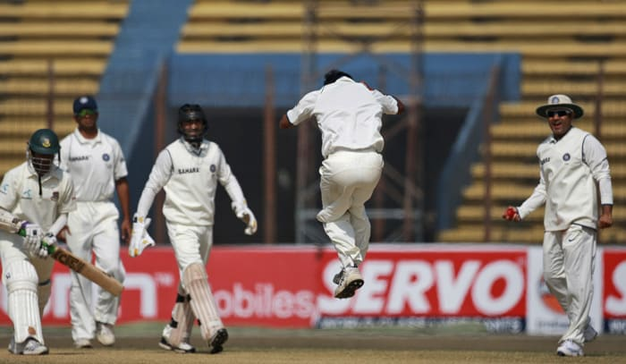 Amit Mishra jumps to celebrate the dismissal Shakib Al Hasan during the fifth day of the first Test between India and Bangladesh in Chittagong. (AP Photo)