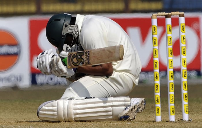 Shakib Al Hasan avoids a bouncer during the fifth day of the first Test match between Bangladesh and India in Chittagong. (AFP Photo)
