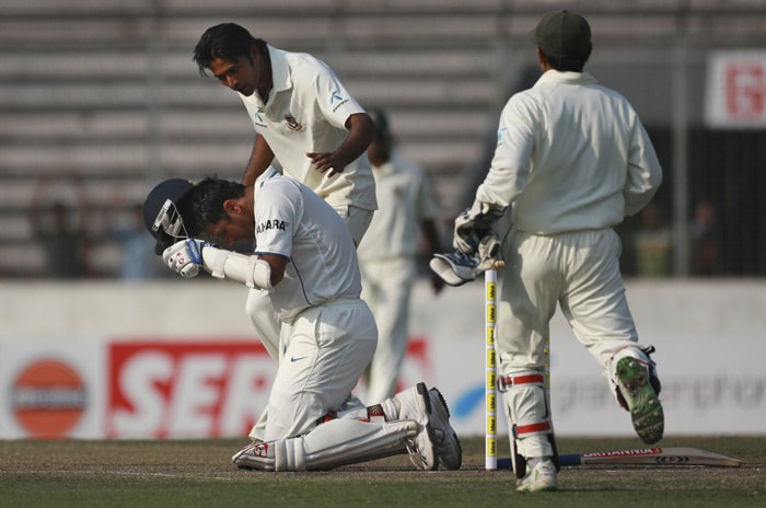 Shahadat Hossain runs in as Rahul Dravid reacts after being injured during the second day of the second Test match against Bangladesh at The Sher-e Bangla National Stadium in Dhaka.
