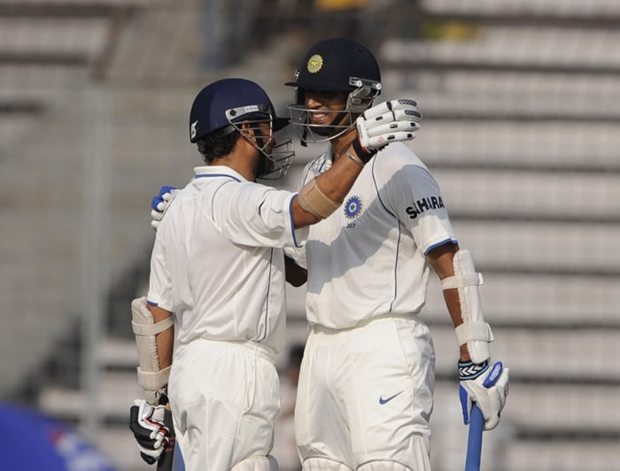 Rahul Dravid hugs teammate Sachin Tendulkar after scoring a century (100 runs) during the second day of the second Test match against Bangladesh at The Sher-e Bangla National Stadium in Dhaka. (AFP Photo)