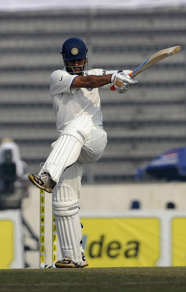 Mahendra Singh Dhoni plays a shot during the third day of the second Test match at The Sher-e Bangla National Stadium in Dhaka. (AFP Photo)