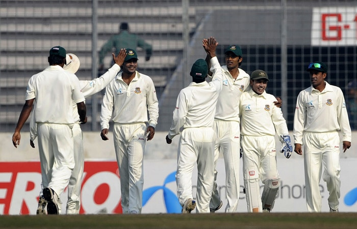 Bangladeshi cricketers celebrate the dismissal of Zaheer Khan during the third day of the second Test match at The Sher-e Bangla National Stadium in Dhaka. (AFP Photo)