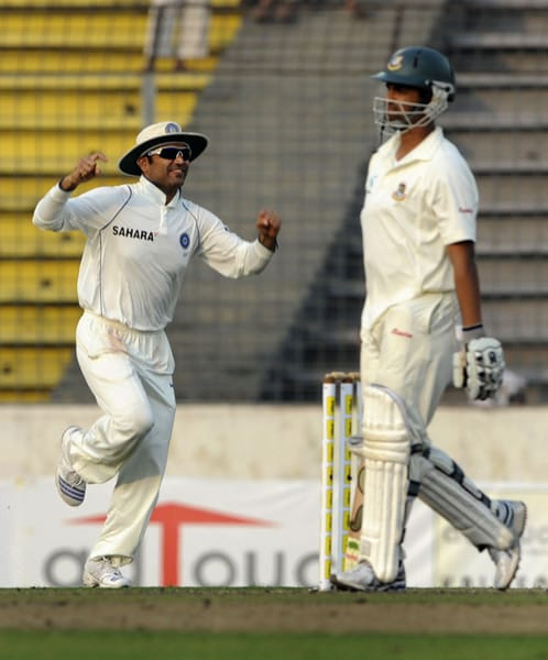 Virender Sehwag celebrates the dismissal of Bangladesh's Tamim Iqbal during the third day of the second Test match at The Sher-e Bangla National Stadium in Dhaka. (AFP Photo)