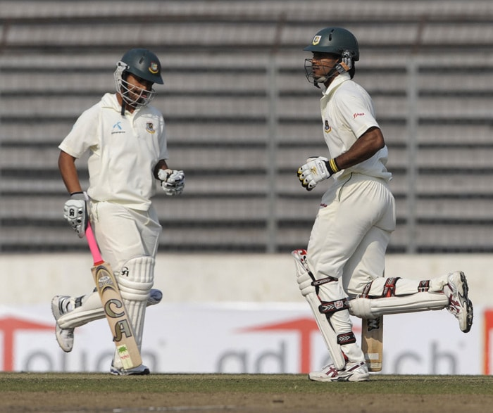 Tamim Iqbal and Junaid Siddique run between wickets during the third day of the second Test series between Bangladesh and India at The Sher-e Bangla National Stadium in Dhaka. (AFP Photo)