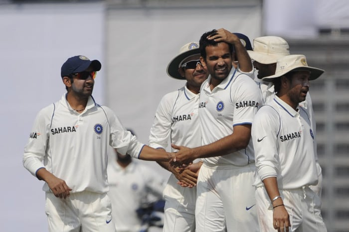 Gautam Gambhir and Virender Sehwag congratulate Zaheer Khan as Sachin Tendulkar looks on during the fourth day of the second Test match in Dhaka. (AFP Photo)