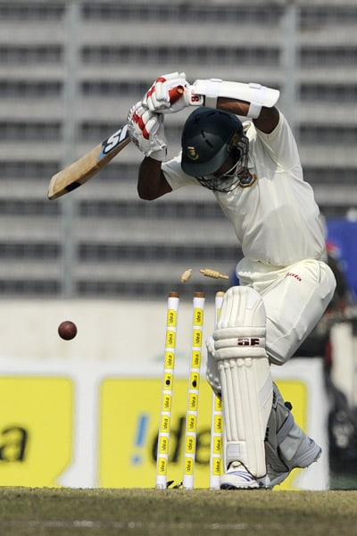 Raqibul Hasan is bowled by Zaheer Khan during the fourth day of the second Test match in Dhaka. (AFP Photo)