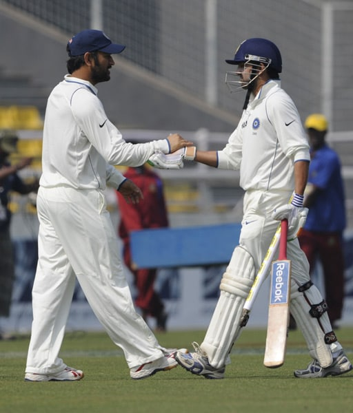 Mahendra Singh Dhoni and his teammate Gautam Gambhir celebrate victory during the fourth day of the second Test match in Dhaka. (AFP Photo)