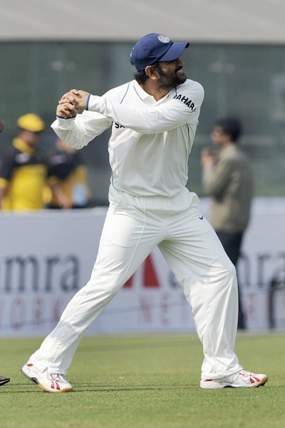 Mahendra Singh Dhoni celebrates victory during the fourth day of the second Test match in Dhaka. (AFP Photo)