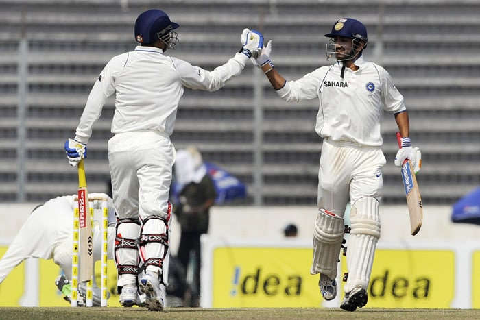 Virender Sehwag and teammate Gautam Gambhir celebrate after defeating Bangladesh during the fourth day of the second Test match in Dhaka. (AFP Photo)