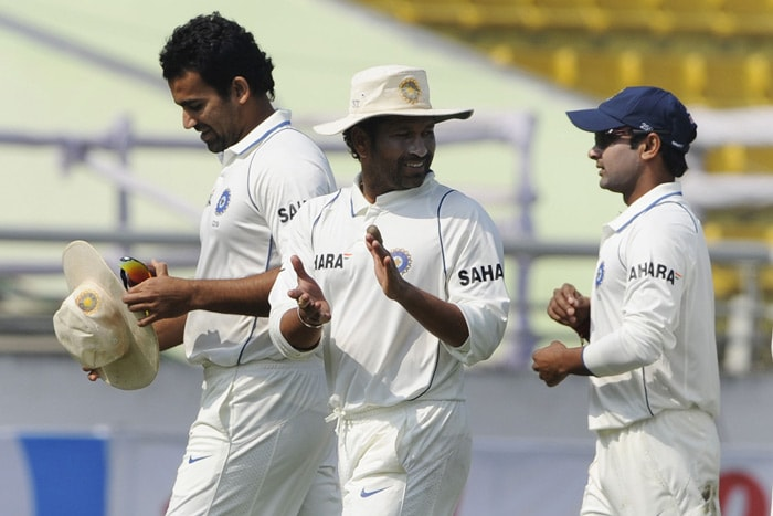 Sachin Tendulkar, Zaheer Khan and Amit Mishra leave the field after defeating Bangladesh during the fourth day of the second Test match in Dhaka. (AFP Photo)