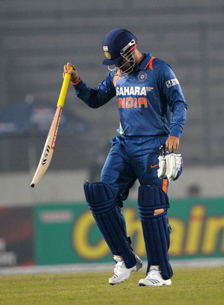 Virender Sehwag reacts after his dismissal during the third ODI against Bangladesh in the tri-series in Dhaka. (AFP Photo)