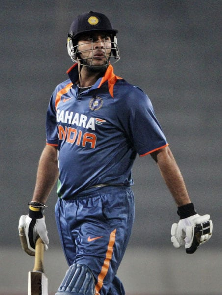Yuvraj Singh reacts after being dismissed by Bangladesh during the third ODI of the tri-series in Dhaka. (AP Photo)