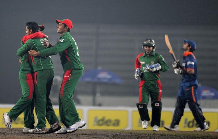 Bangladeshi cricketers celebrate after the dismissal of Virat Kohli during the third ODI of the tri-series in Dhaka. (AFP Photo)