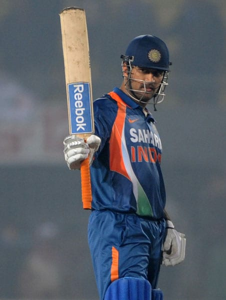 Mahendra Singh Dhoni acknowledges the crowd after scoring a century against Bangladesh during the third ODI of the tri-series in Dhaka. (AFP Photo)