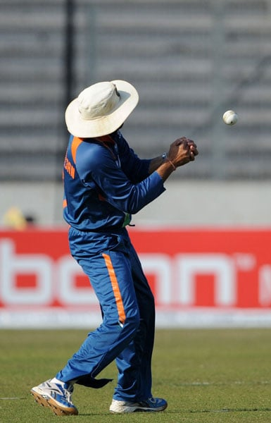 Harbhajan Singh attempts a catch during the third ODI of the tri-series against Bangladesh in Dhaka. (AFP Photo)