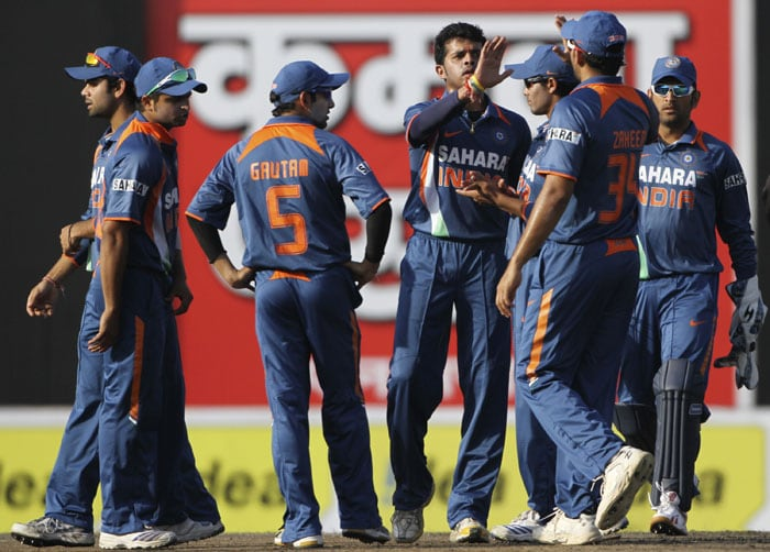 S Sreesanth celebrates with teammates the dismissal of Tamim Iqbal during the third ODI of the tri-series in Dhaka. (AP Photo)