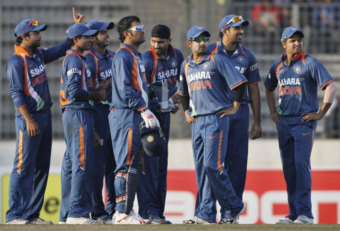 Virat Kohli gestures as he waits with teammates for the decision on Shakib Al Hasan from the third umpire during the third ODI of the tri-series in Dhaka. (AP Photo)