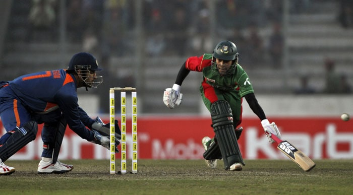 Mushfiqur Rahim attempts to make it to the crease to avoid a run-out as Indian captain Mahendra Singh Dhoni takes his position during the third ODI of the tri-series in Dhaka. (AP Photo)