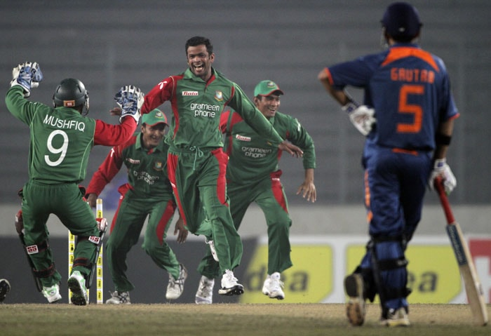 Abdur Razzak jumps to celebrate the dismissal of Virender Sehwag as Gautam Gambhir looks on during the third ODI of the tri-series in Dhaka. (AP Photo)