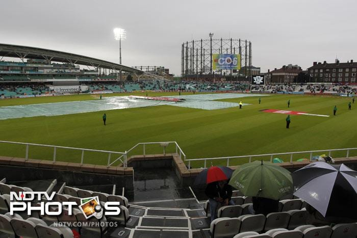 Rain covers are pictured on the wicket as rain interrupts play on the first day of the fourth Test between England and India at The Oval Cricket Ground in London. (AFP Photo)
