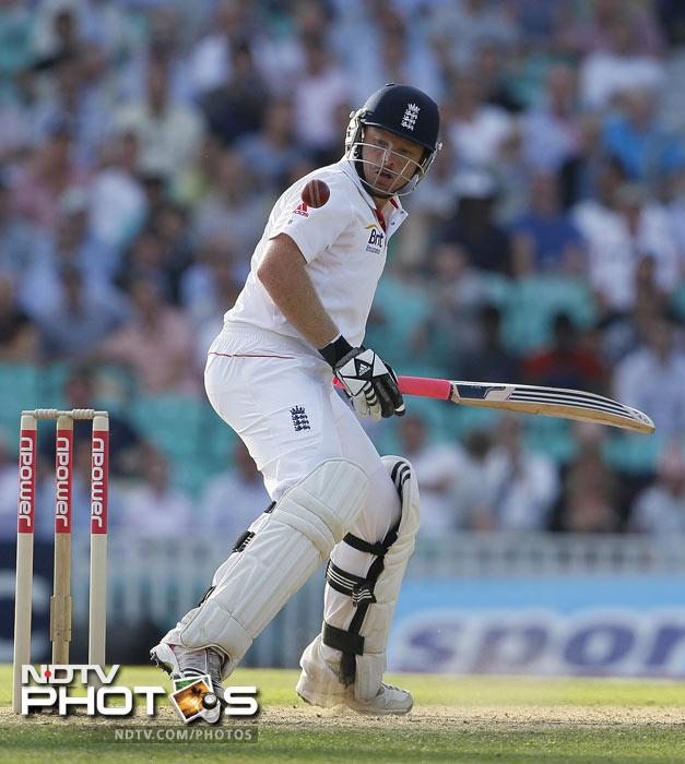 Ian Bell watches the ball after he plays a shot off the bowling of Ishant Sharma in their fourth Test match at The Oval Cricket Ground in London. (AP Photo)
