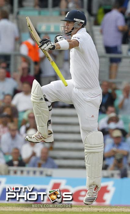 Kevin Pietersen celebrates after reaching his century during the second day of the fourth Test match between England and India at The Oval Cricket Ground in London. (AFP Photo)