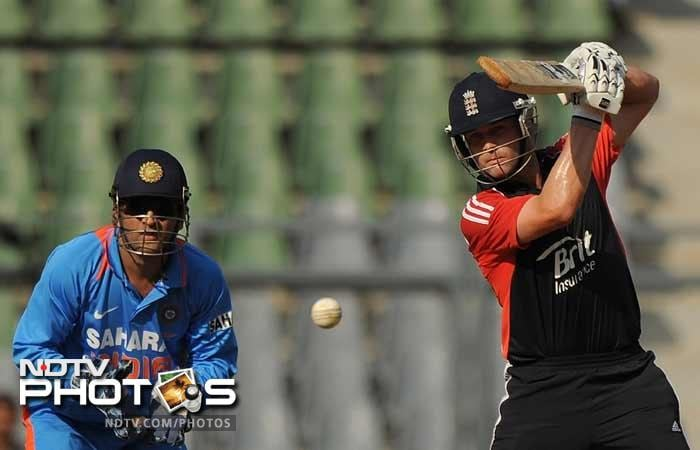 Jonathan Trott plays a shot as Mahendra Singh Dhoni watches during the fourth One-Day International between India and England at the Wankhede stadium in Mumbai. (AFP Photo)