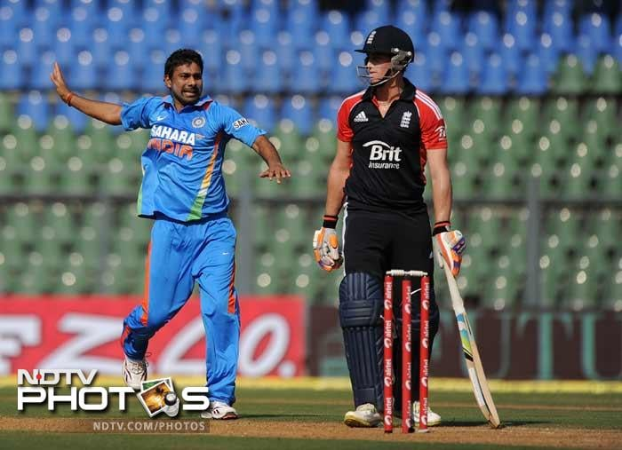 Praveen Kumar celebrates after taking the wicket of Craig Kieswetter during the fourth One-Day International between India and England at the Wankhede stadium in Mumbai. (AFP Photo)