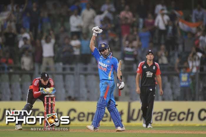 Virat Kohli celebrates after India won the 4th One-Day International against England at the Wankhede stadium in Mumbai. India won by 6 wickets. (AFP Photo)
