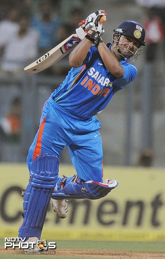 Suresh Raina plays a shot during the fourth One-Day International between India and England at the Wankhede stadium in Mumbai. (AFP Photo)